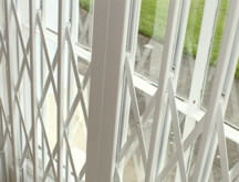 Retractable security grilles